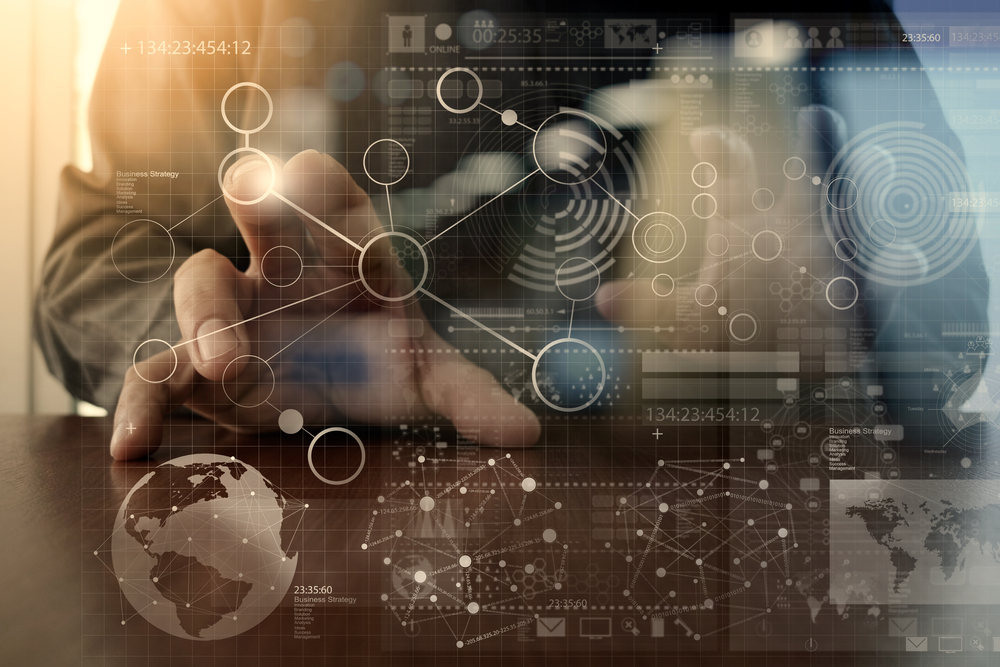 businessman hand working with modern technology and digital layer effect as business strategy concept